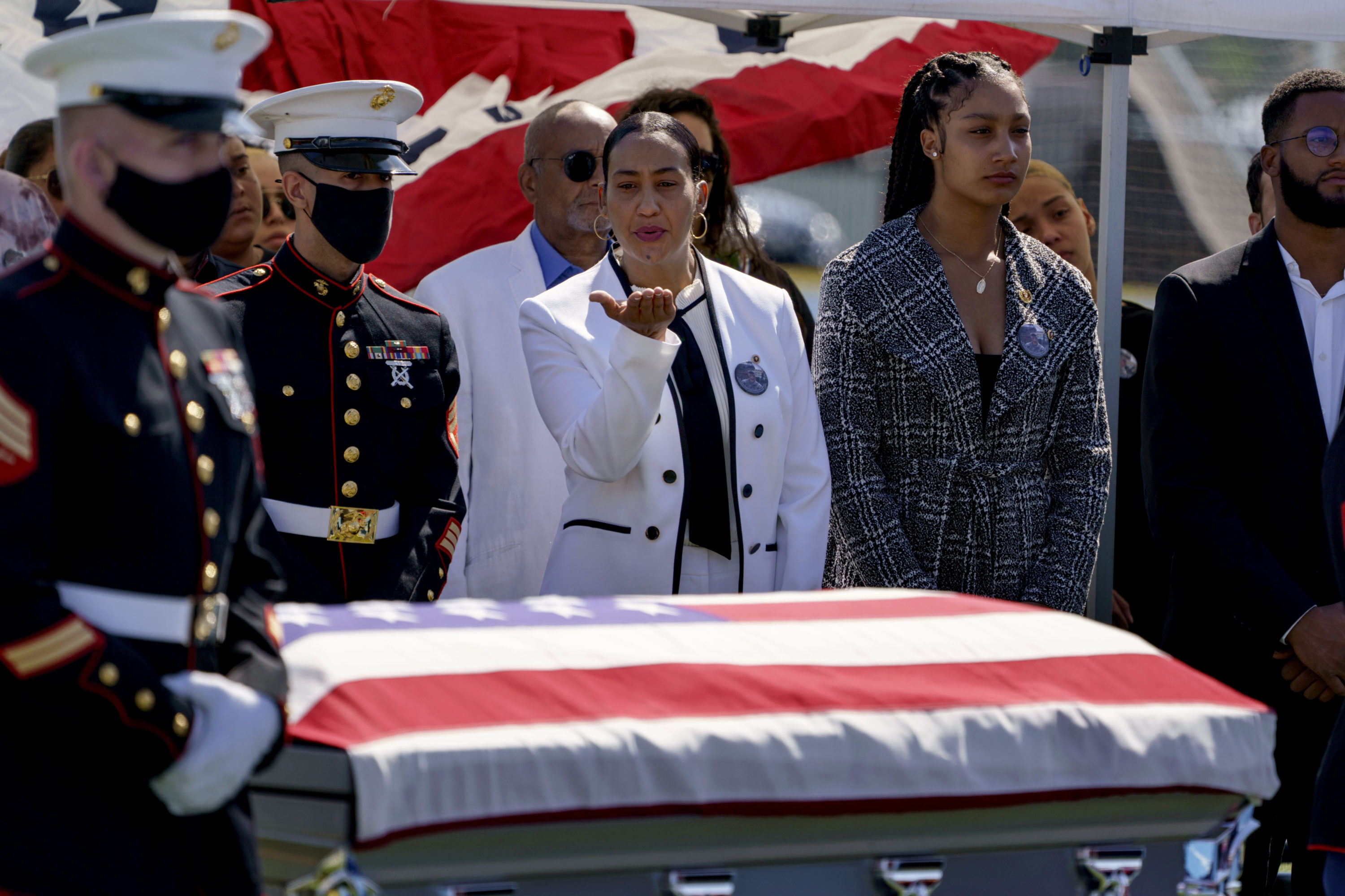 Colasa Pichardo, center, blows a kiss toward the casket of her daughter, Sgt. Johanny Rosario, a U.S. Marine who was among 13 service members killed in a suicide bombing in Afghanistan, during a public wake in her hometown of Lawrence on Tuesday. (David Goldman/AP)