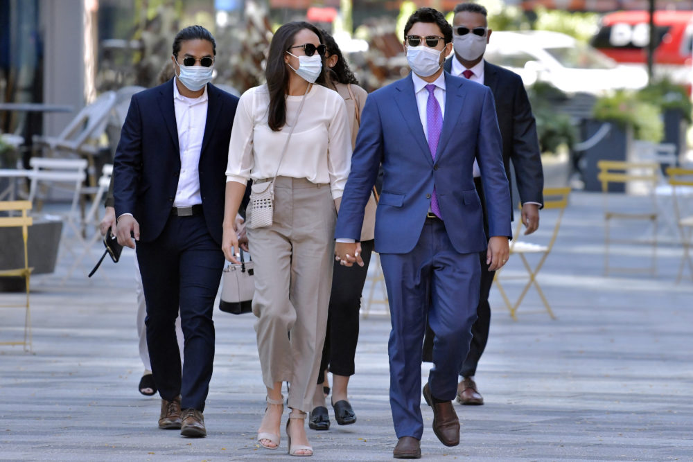 Former Fall River, Mass. Mayor Jasiel Correia, right, arrives with his wife Jenny Fernandes, center, and family members for a court appearance at the John Joseph Moakley United States Courthouse, Monday, Sept. 20, 2021, in Boston. (Josh Reynolds/ AP Photo)