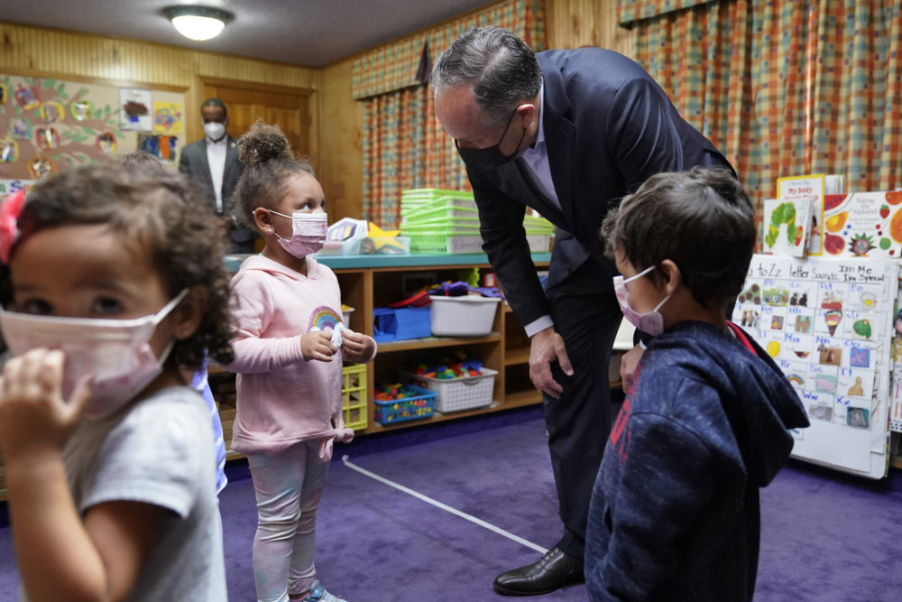 Douglas Emhoff, top right, husband of Vice President Kamala Harris, speaks to pre-school children after reading The Very Hungry Caterpillar, by Eric Carle, at Mother Hubbard Pre-School Center, Monday, Sept. 20, 2021, in Milford, Mass. (Steven Senne/AP Photo)