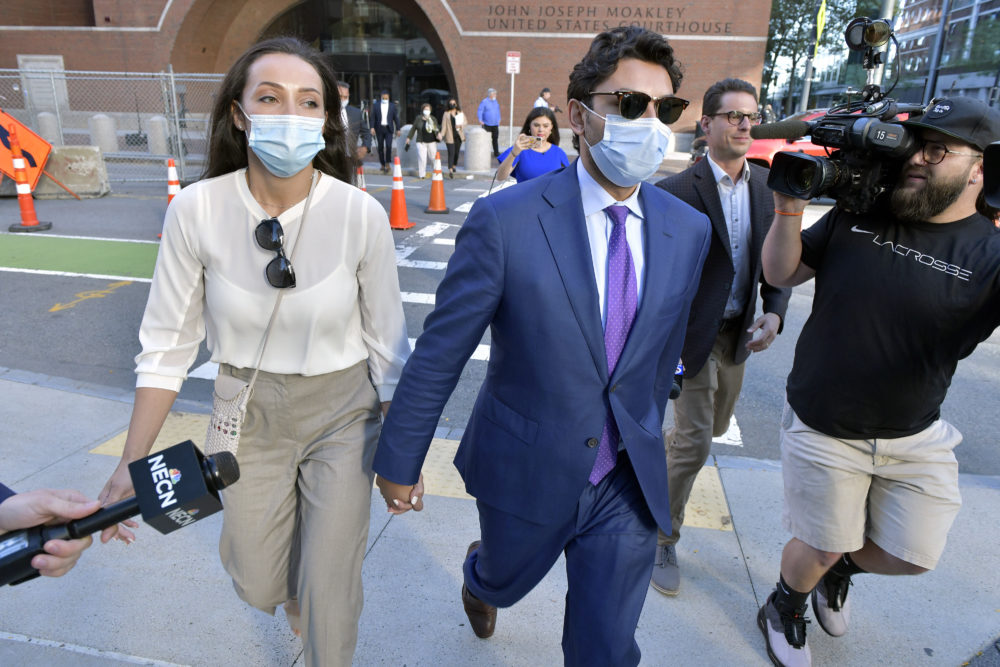 Jasiel Correia and his wife, Jenny Fernandes, leave the John Joseph Moakley United States Courthouse in Boston on Monday. (Josh Reynolds/AP)