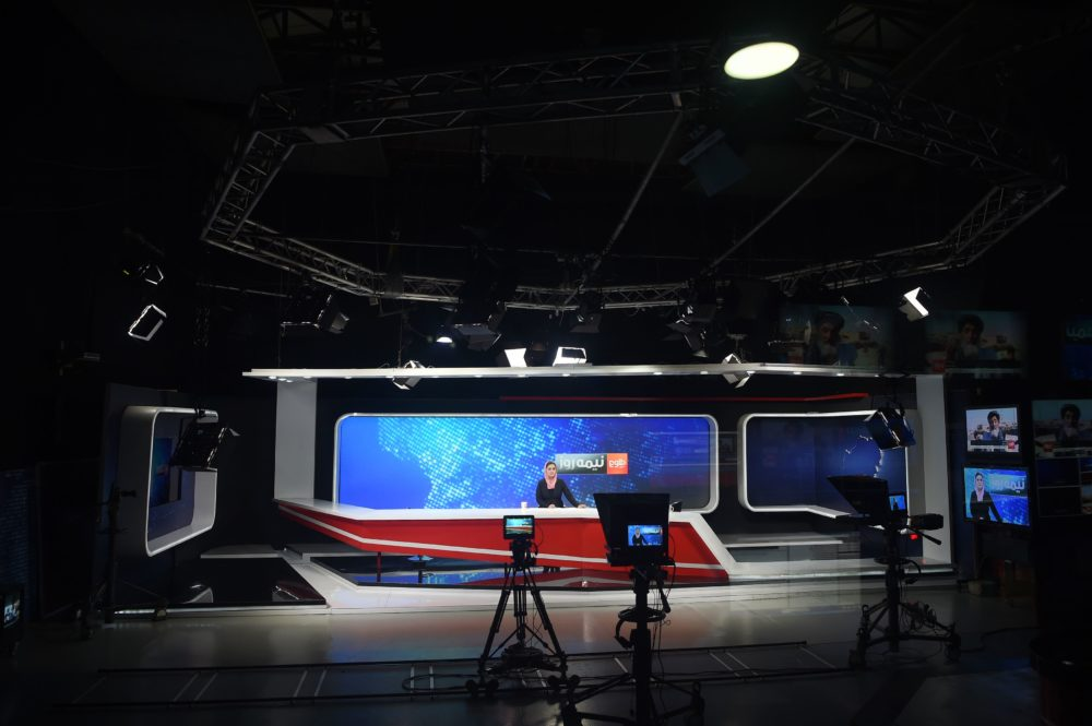 Afghan presenter Zarmina Mohammadi for TOLOnews takes part in a live broadcast at in Kabul in 2018. (WAKIL KOHSAR/AFP via Getty Images)