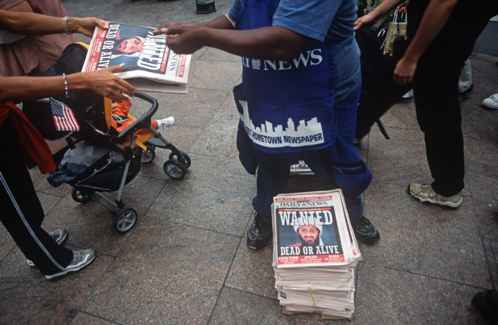 A week after the 9/11 terrorist attack on the Twin Towers and the Pentagon, a newspaper vendor sells copies of the New York Daily News with the face of Osama bin Laden and a cowboy-era outlaw's headline of 'Dead or Alive,' September 18, 2001.(Richard Baker/ Getty Images)