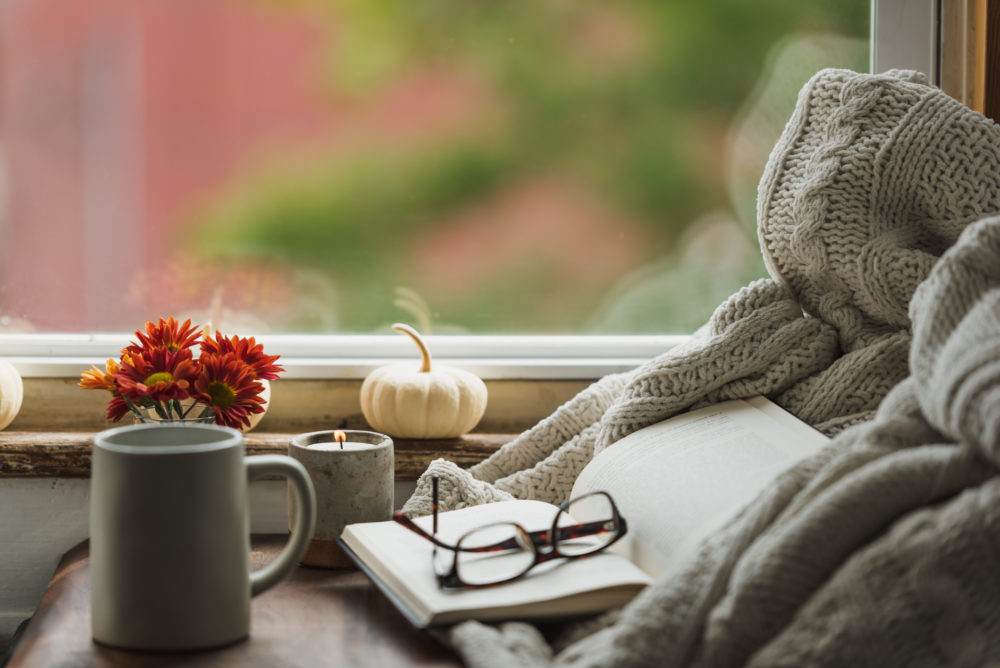 Get cozy with a new book. (Getty Images)