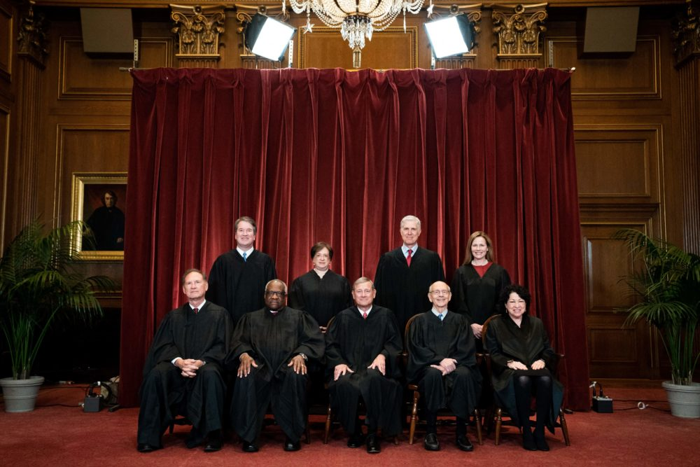 Seated from left: Associate Justice Samuel Alito, Associate Justice Clarence Thomas, Chief Justice John Roberts, Associate Justice Stephen Breyer and Associate Justice Sonia Sotomayor, standing from left: Associate Justice Brett Kavanaugh, Associate Justice Elena Kagan, Associate Justice Neil Gorsuch and Associate Justice Amy Coney Barrett pose during a group photo of the Justices at the Supreme Court in Washington, DC on April 23, 2021. (Erin Schaff/AFP via Getty Images)