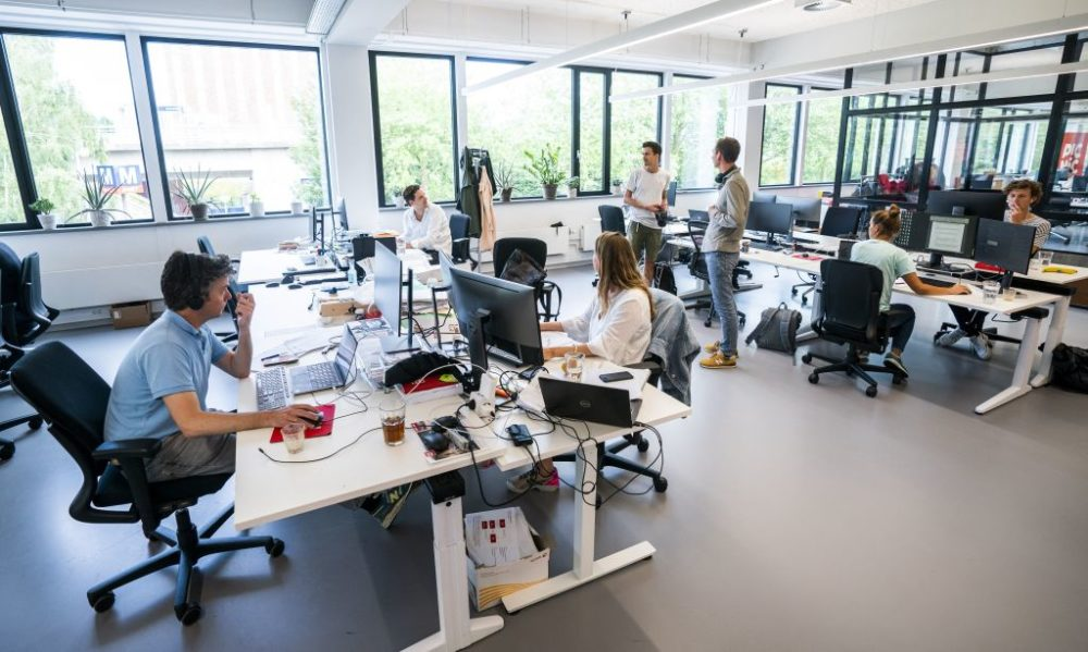 Employees working at an office in the Netherlands on June 28, 2021. (Jeroen Jumelet/Getty Images)