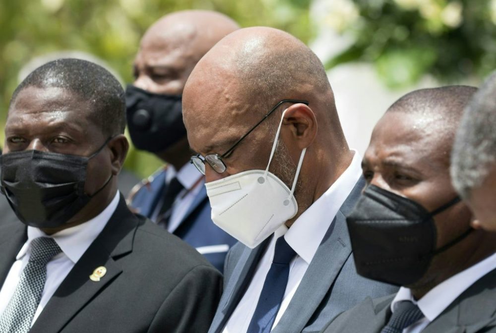 Prime Minister Ariel Henry (center) attends a ceremony in honor of late Haitian President Jovenel Moise at the National Pantheon Museum in Port-au-Prince, Haiti, on July 20, 2021. (Photo by Valerie Baeriswyl Getty Images)