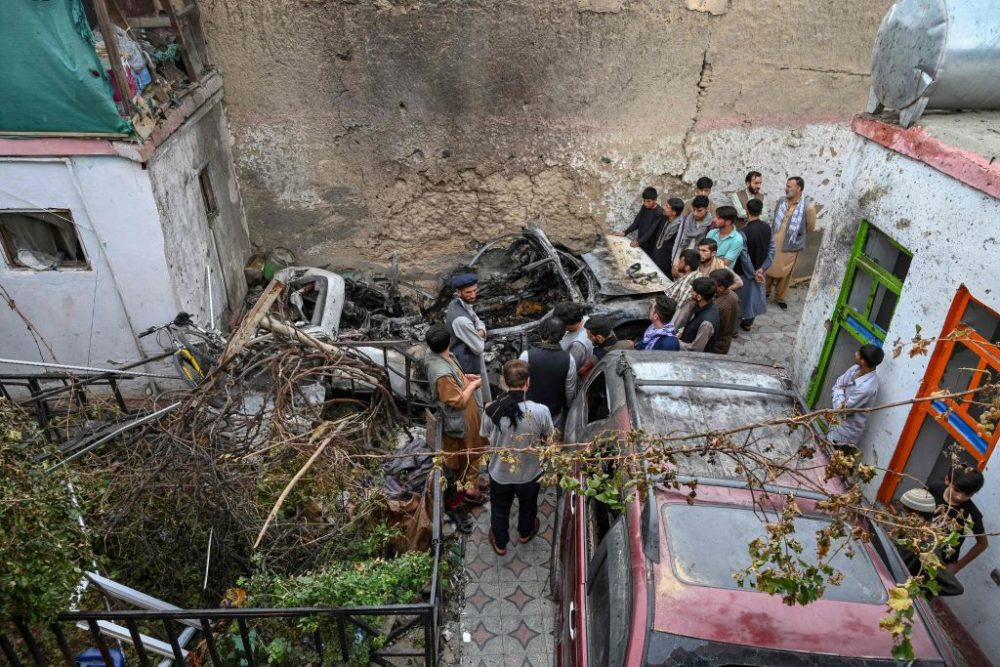 Afghan residents and family members of the victims gather next to a damaged vehicle inside a house, day after a U.S. drone airstrike in Kabul on Aug. 30, 2021. (Wakil Kohsar/Getty Images)