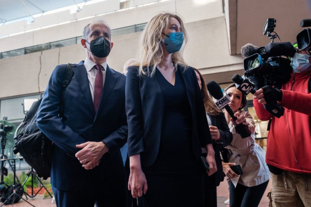 Elizabeth Holmes, the founder and former CEO of blood testing and life sciences company Theranos, arrives for the first day of jury selection in her fraud trial (Nick Otto/ Getty Images)