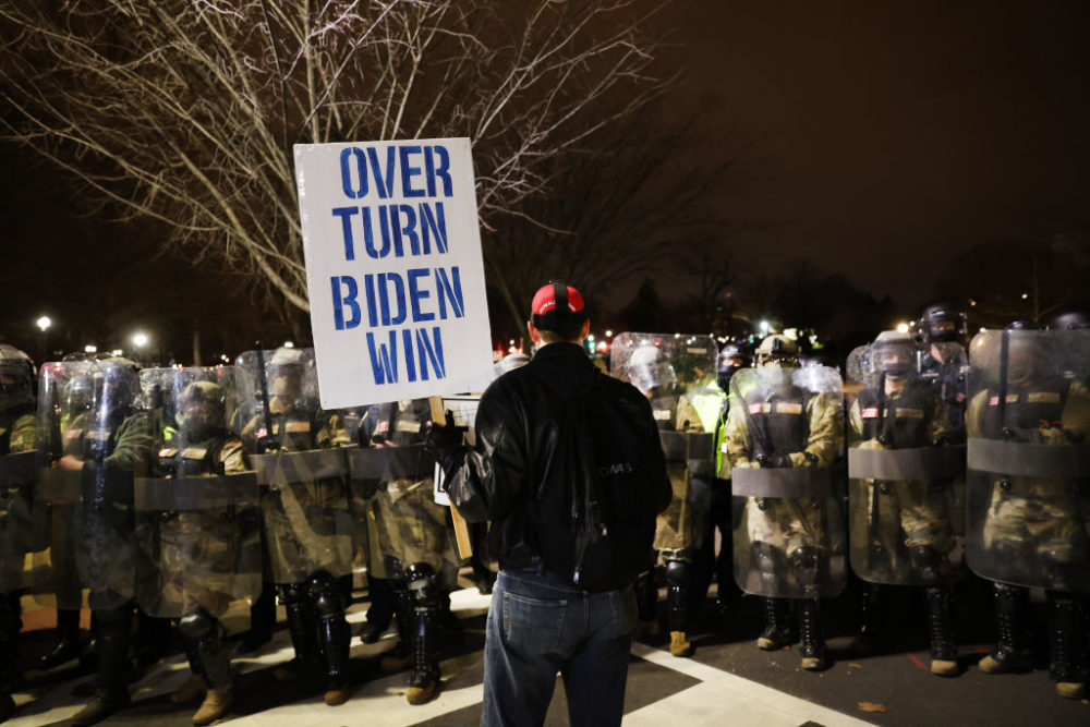 Members of the National Guard and the Washington, D.C., police keep a small group of demonstrators away from the Capitol. (Spencer Platt/Getty Images)