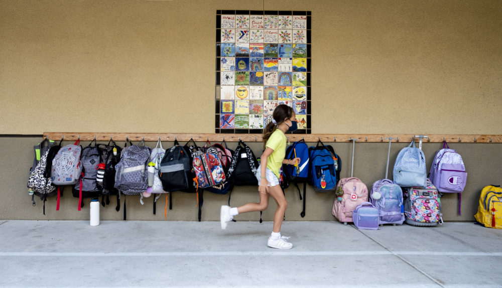 A student rushes to her classroom for the first day of class at Laguna Niguel Elementary School in Laguna Niguel, CA on Tuesday, August 17, 2021. (Paul Bersebach/Getty Images)