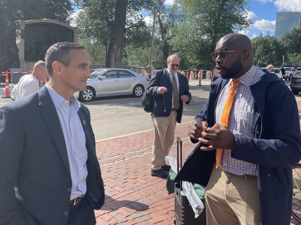Mayor of Somerville Joe Curtatone and Jarred Johnson of TransitMatters both spoke at the rally for more MBTA funding and oversight. (Darryl C. Murphy/WBUR)