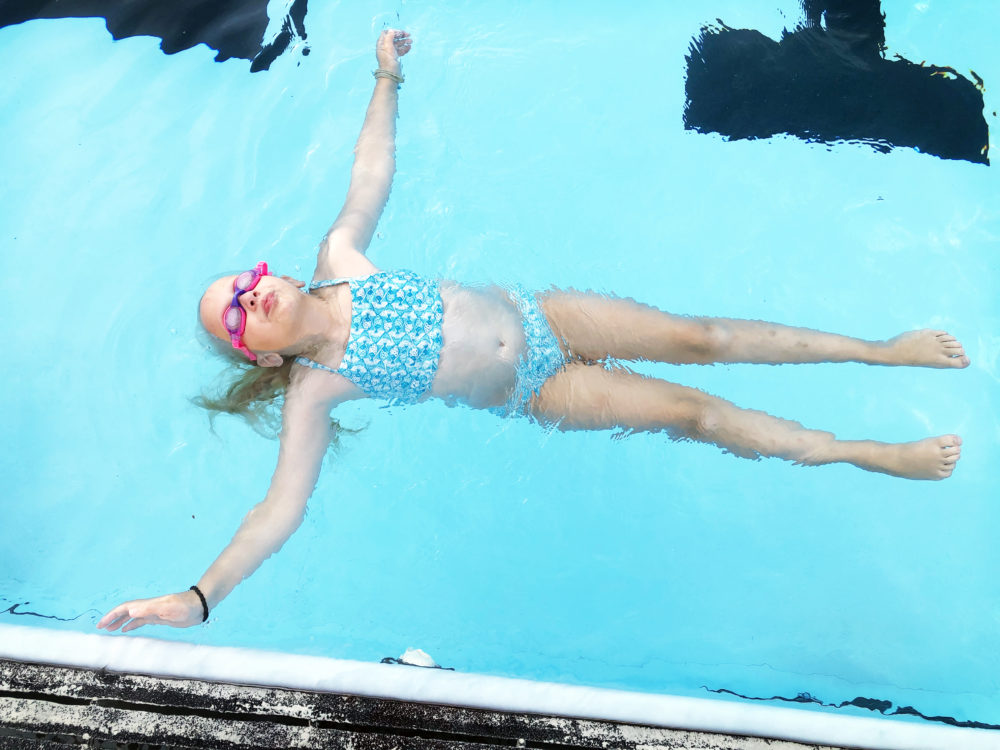 The author's daughter, floating in their local swimming pool. (Courtesy Traer Scott)