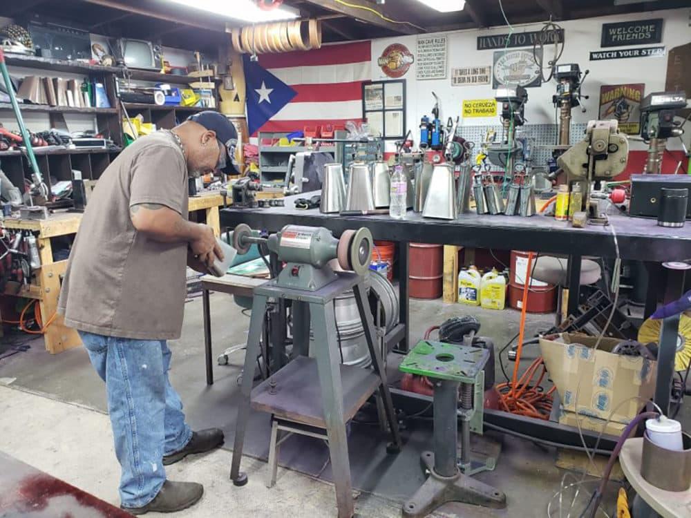Ulisis Santiago in his workshop. (Maayan Silver)