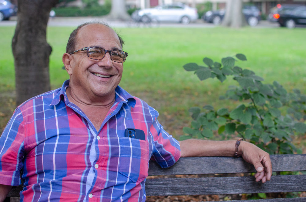 """Ray Magliozzi sits on a park bench to discuss the end of airing """"Car Talk"""" on the radio. (Sharon Brody/WBUR)"""