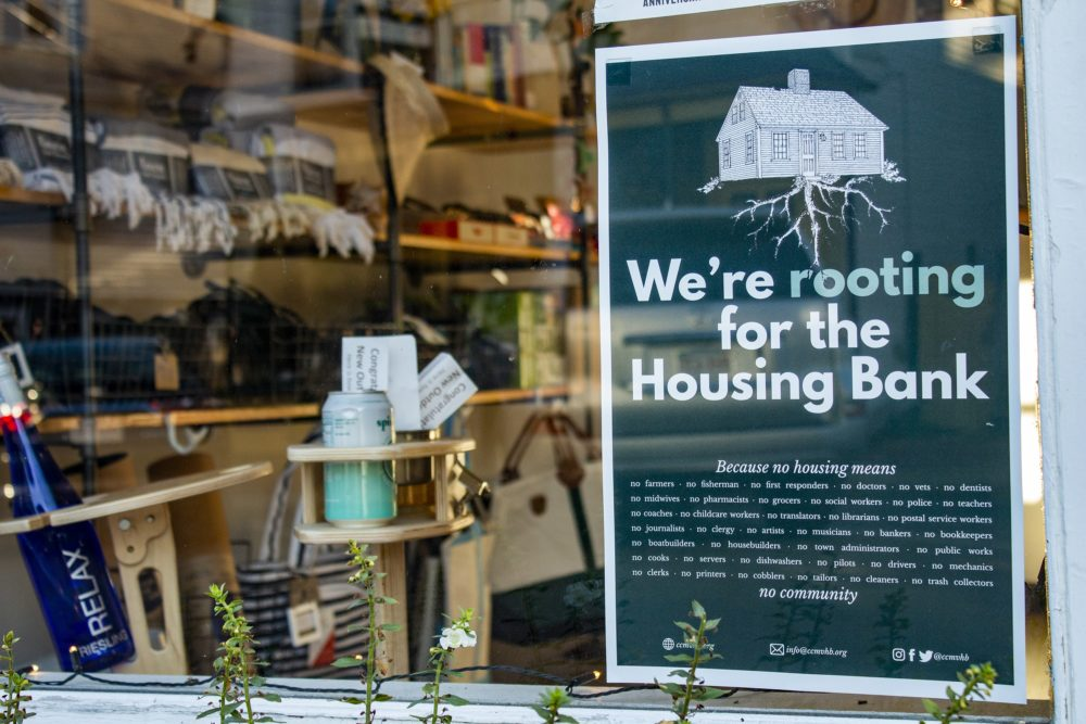 A sign in the Lani Beach Club storefront in Vineyard Haven shows support for the Martha's Vineyard Housing Bank. (Wilder Fleming/WBUR)