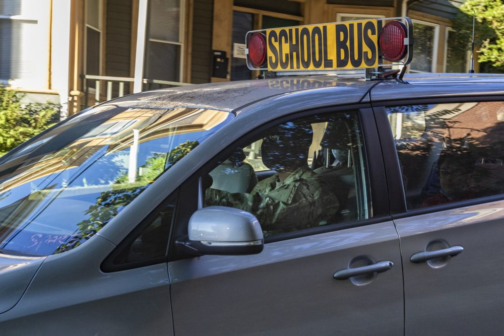 A National Guard member drives a school bus van in Chelsea. (Jesse Costa/WBUR)