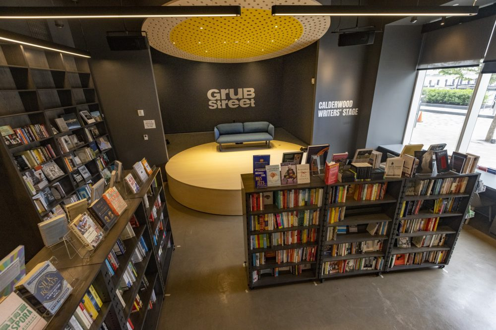 The GrubStreet stage and events area has bookshelves with wheels that can be moved in order to hold large literary gatherings. (Jesse Costa/WBUR)