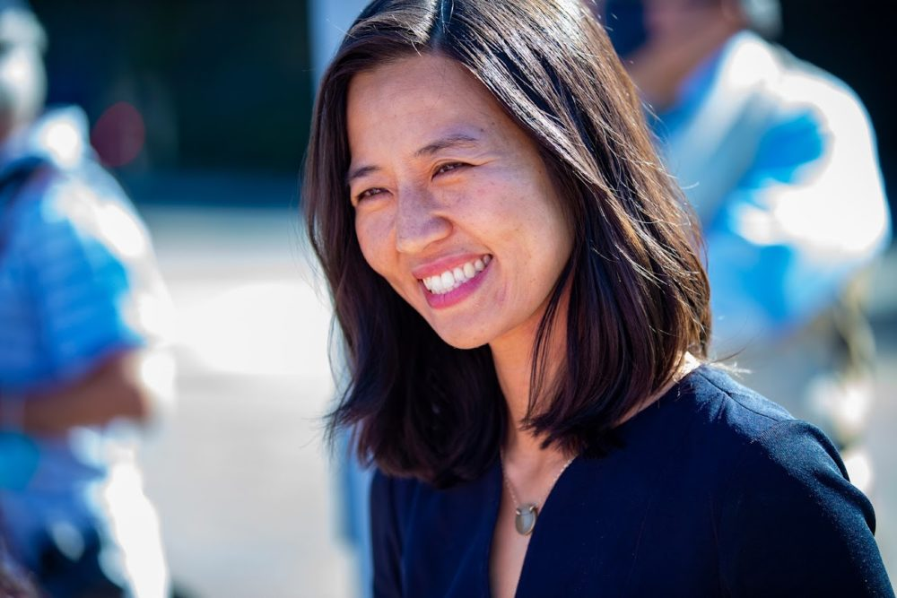 Boston mayoral candidate Michelle Wu greets with supporters at Readville Station in Hyde Park. (Jesse Costa/WBUR)