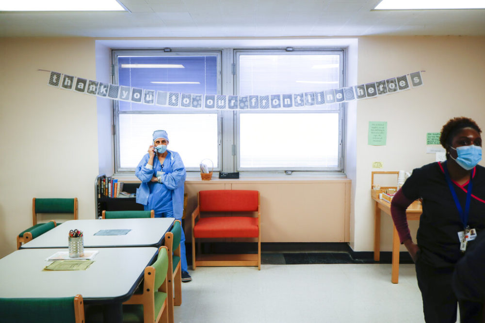 A medical worker takes a break in the employee respite facility at NYC Health + Hospitals Metropolitan, Wednesday, May 27, 2020, in New York.  (John Minchillo/AP)