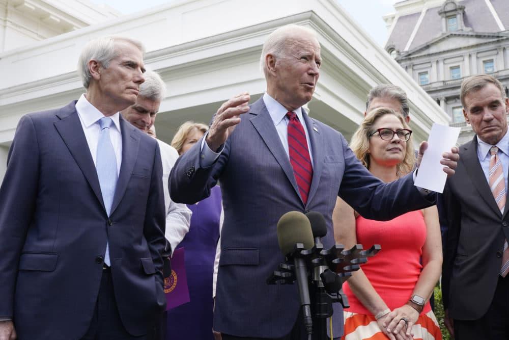 President Joe Biden, with a bipartisan group of senators, speaks Thursday June 24, 2021, outside the White House in Washington. (AP Photo/Jacquelyn Martin)