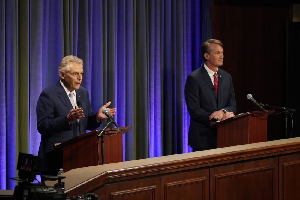 Democratic gubernatorial candidate and former Gov. Terry McAuliffe (left) gestures as his Republican challenger, Glenn Youngkin, looks on during a debate at the Appalachian School of Law in Grundy, Va., on Sept. 16, 2021. (Steve Helber/AP)