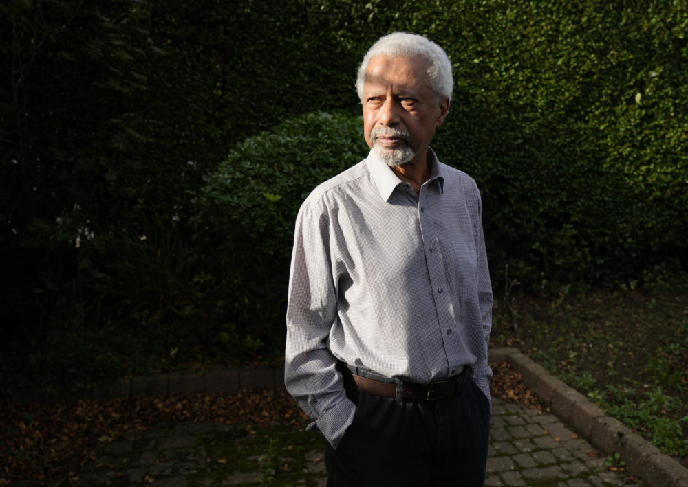 """Tanzanian writer Abdulrazak Gurnah poses for a photo at his home in Canterbury, England, on Oct. 7, 2021. Gurnah was awarded the 2021 Nobel Prize for Literature. The Swedish Academy said the award was in recognition of his """"uncompromising and compassionate penetration of the effects of colonialism."""" (Frank Augstein/AP)"""