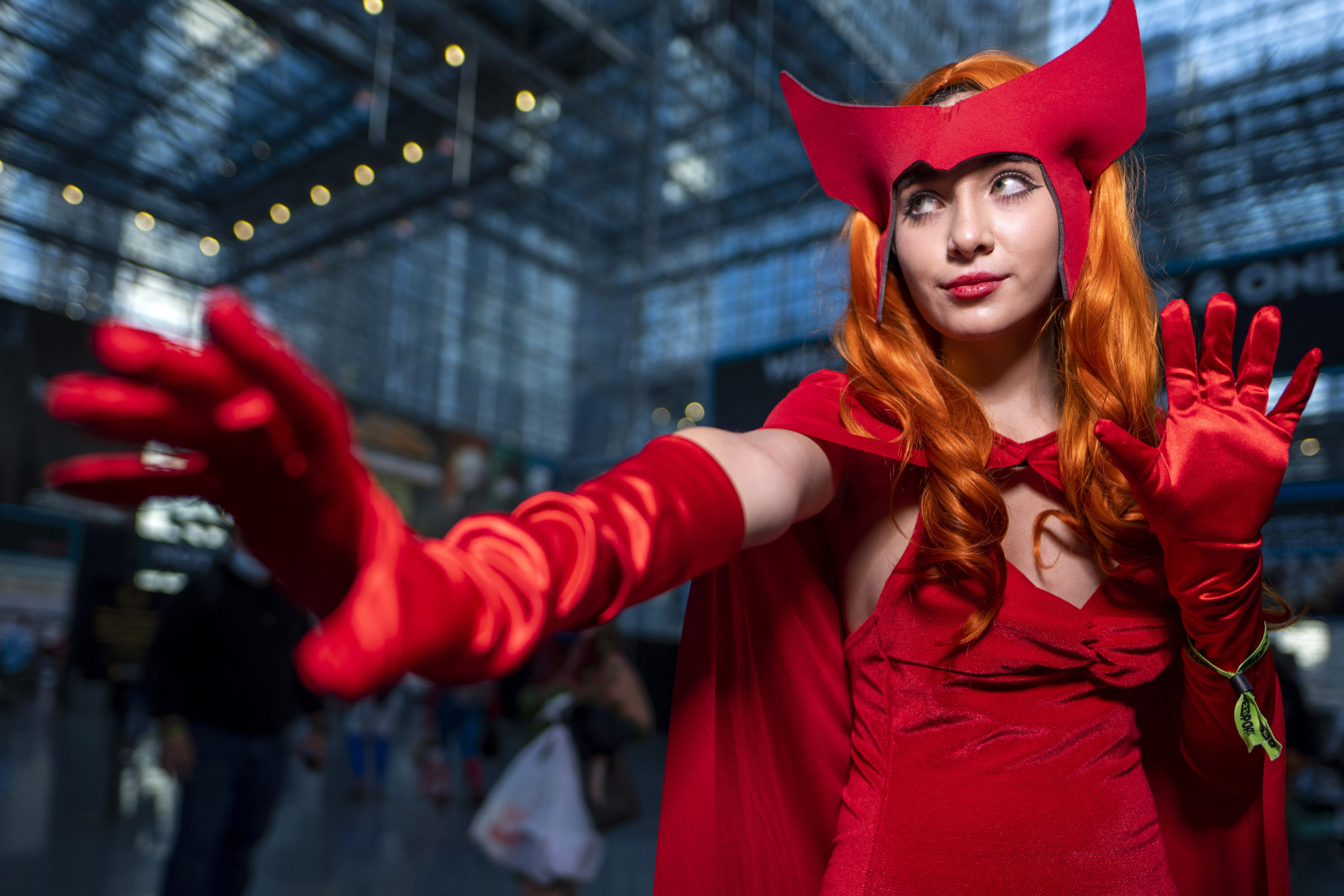 An attendee dressed as Wanda Maximoff poses during New York Comic Con on Thursday, Oct. 7, 2021, in New York. (Charles Sykes/Invision/AP)