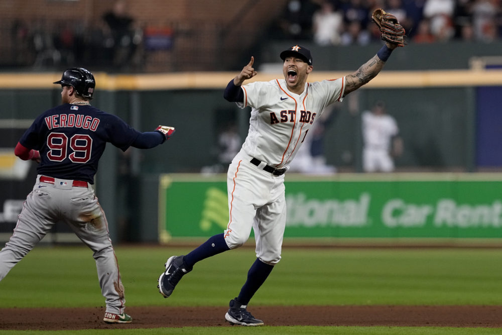Houston Astros shortstop Carlos Correa celebrates after tagging out Boston Red Sox's Alex Verdugo at second to end the top of the seventh inning in Game 6 of baseball's American League Championship Series Friday, Oct. 22, 2021, in Houston. (Tony Gutierrez/AP)