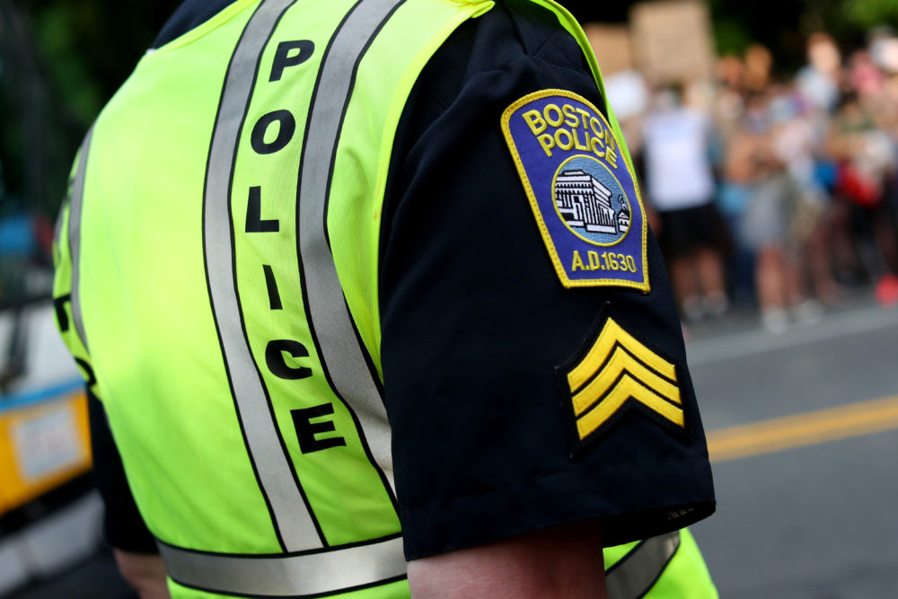 A Boston police officer stood outside a protest in June 2020. (Maddie Meyer/Getty Images)