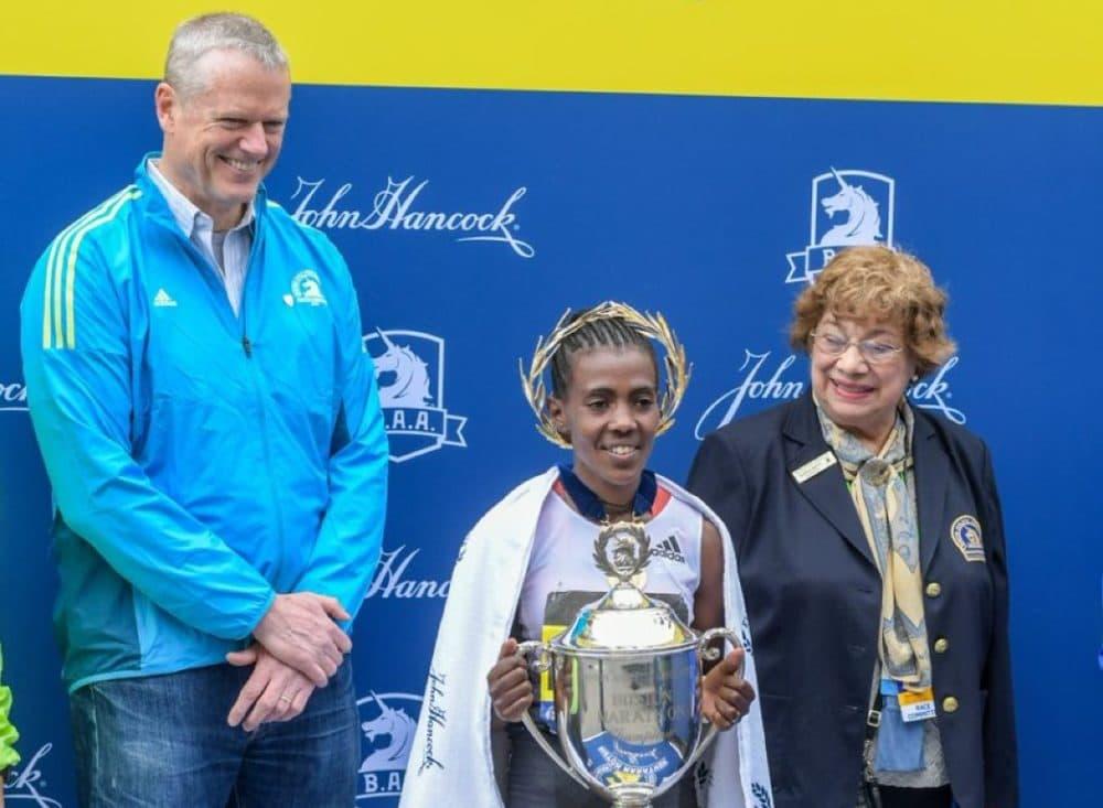 Gloria Ratti (R) with Boston Marathon winner Worknesh Degefa and Gov. Charlie Baker at the finish line in 2019. (Courtesy Boston Athletic Association)