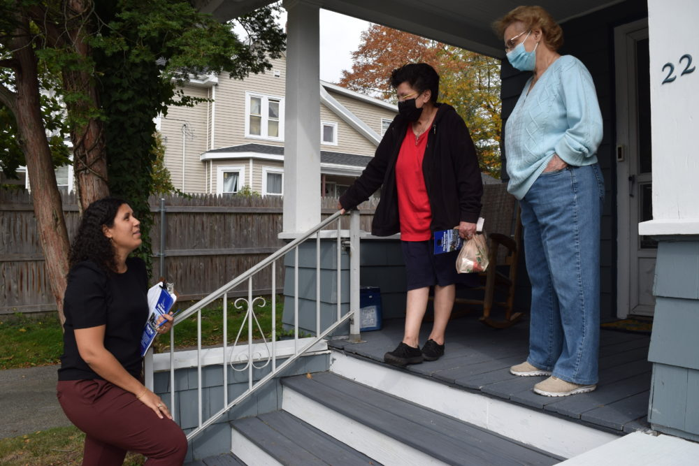 Brockton At-Large City Councilor Rita Mendes talks with voters Theresa Gonzalez and Nancy Glenn about the upcoming municipal election, and about changes coming to the city because of legislative redistricting. (Steve Brown/WBUR)