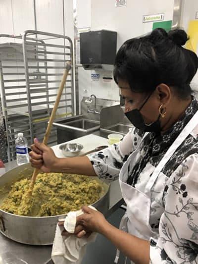 Chef Shanthini making samosas. (Karyn Miller-Medzon/Here & Now)