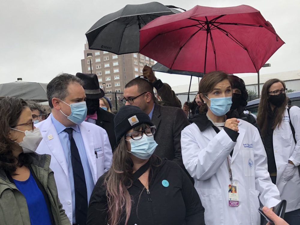 Doctors, politicians and advocates stood outside of the Suffolk County Jail Wednesday to oppose plans to build a makeshift courtroom and addiction treatment center inside the facility. (Deb Becker/WBUR)