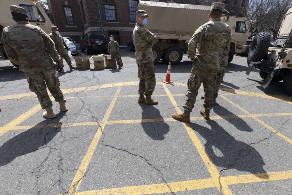 Massachusetts National Guard soldiers help with logistics in April 2020 file photo, at a food distribution site in Chelsea, Mass. (Michael Dwyer/AP)