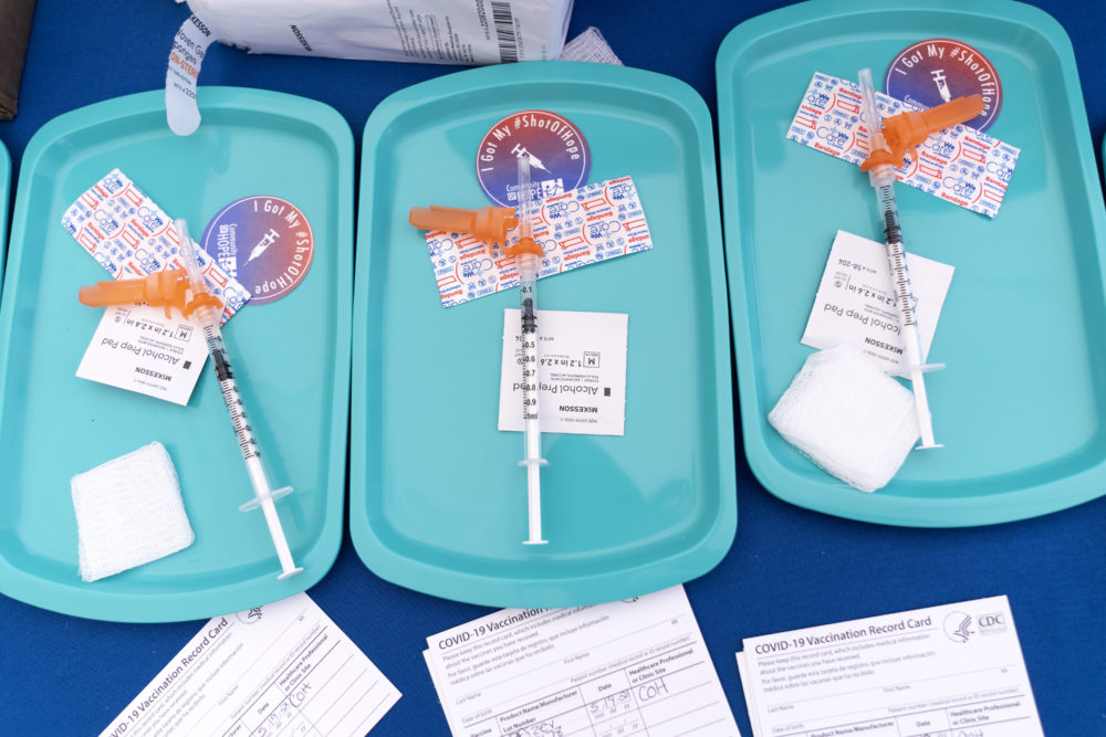 In this May 2021 file photo, Pfizer COVID-19 vaccine doses are prepared for members of the community 12 years and up, at a clinic in southeast Washington. (Jacquelyn Martin/AP)